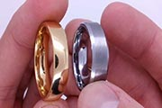 The titanium ring differs from the gold ring